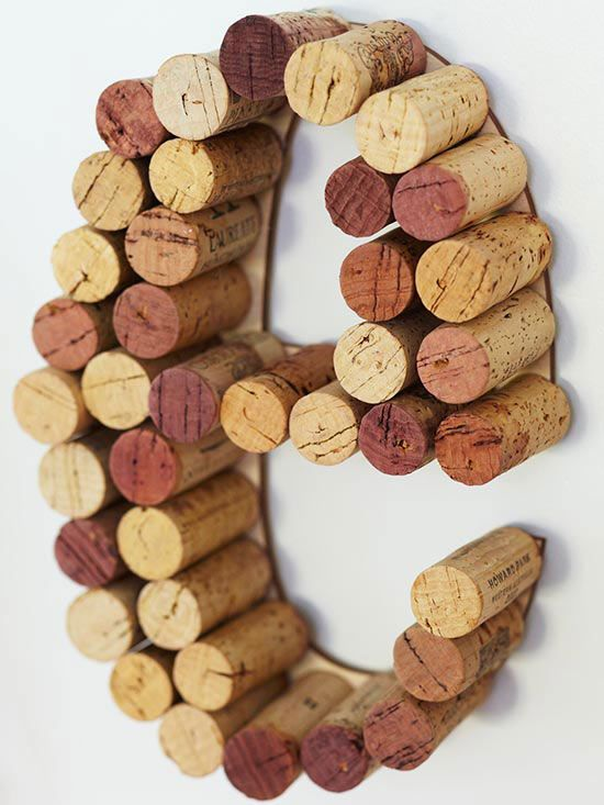 To create these festive cork letters, start by purchasing flat wooden letters from your local crafts store. Then, affix the wine corks to the letter-form using hot glue. Adhere the letters to the wall using removable adhesive strips. Bonus Tip: Spell out any word you desire, just make sure you'll have enough corks on hand to get the job done!