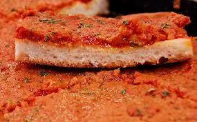 Lo Sfincione rappresenta il piatto tipico del palermitano, equivalente siciliano della pizza napoletana. L'origine della sua struttura è probabilmente araba, ma il nome è stato attribuito in Sicilia.  L'etimologia del nome si associa alla sua morbidezza.