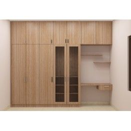Modular wardrobe with book shelf, loft and study unit. Made up of plywood with laminate finish. Hinged door wardrobe with wooden and glass door cabinet brings a stylish look. Customize this wardrobe as per the room size and make the bedroom look astonishing with caliber furniture. Maximize the floor space by customizing multiple units at the same space.