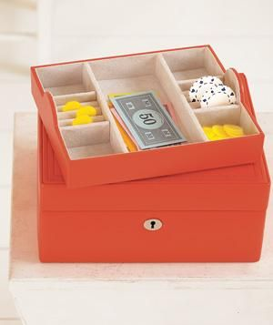 Got an old jewelry box collecting dust? Store stray game pieces in it.