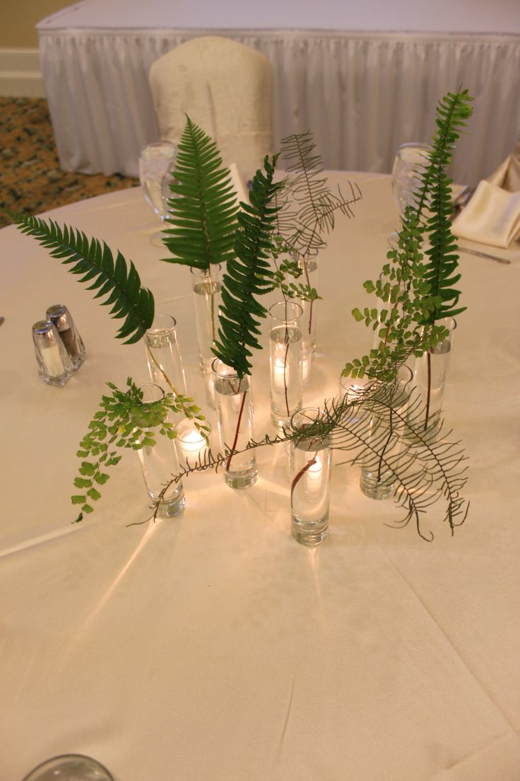 we'll have some little accent bottles like this with ferns and wildflowers around the reception space