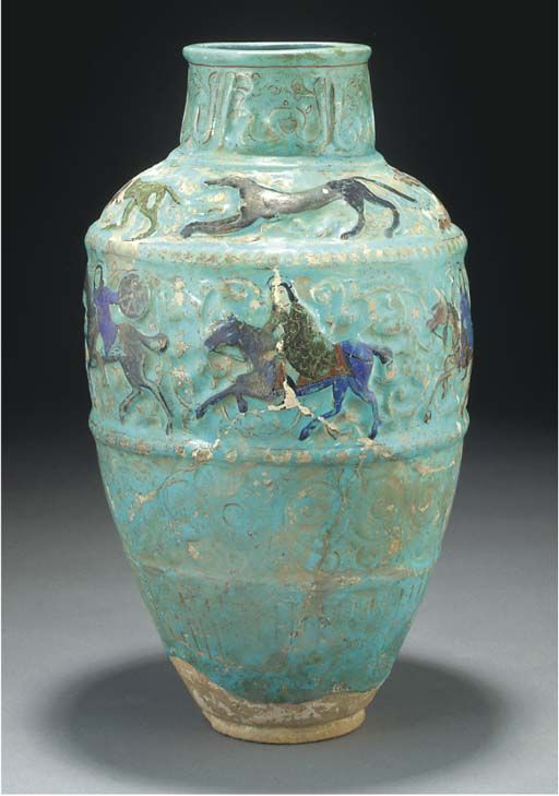 A Mina'i turquoise glazed pottery storage jar, Iran, 12th century or later