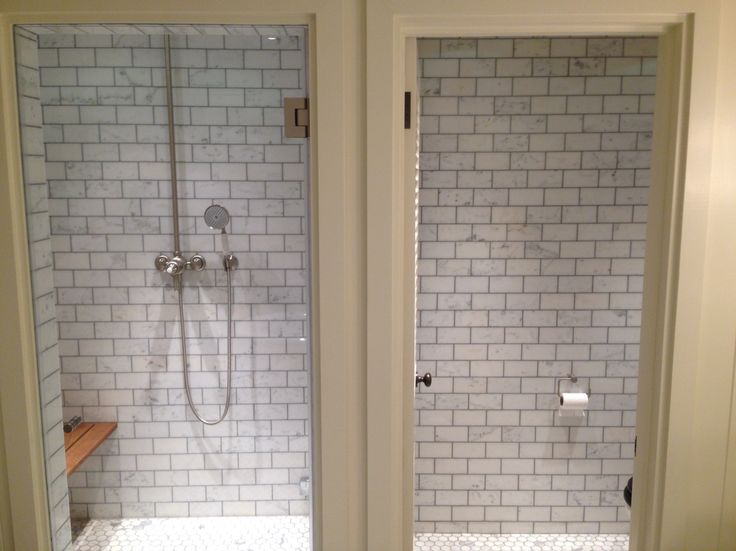 Side by side shower room and WC tiled in brick pattern marble tiles with marble mosaic floors.