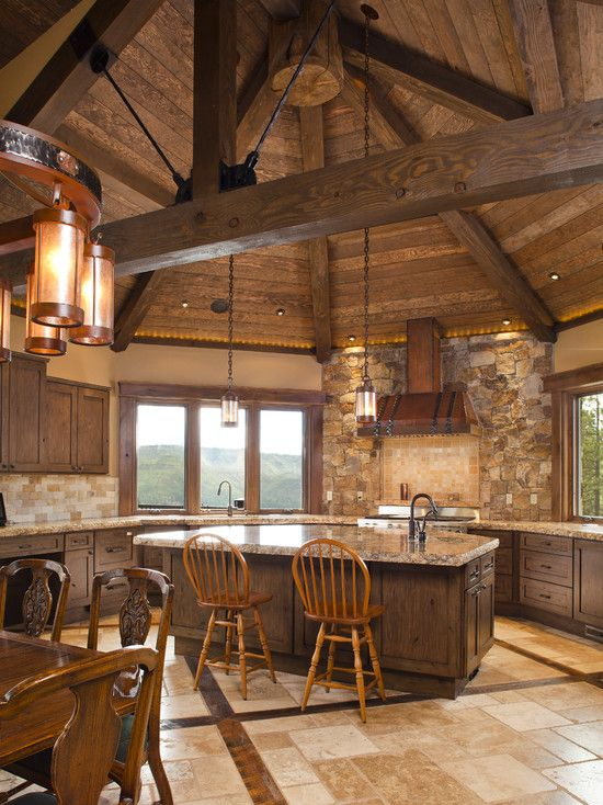 Log cabin kitchen with breakfast bar island and amazing tile work on the floor