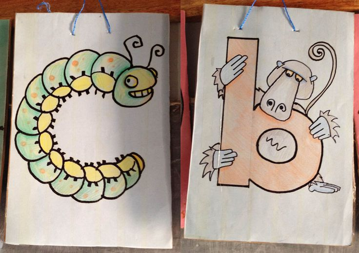 A fun way to introduce sounds: have a picture letter card. Create your own, you don't have to reproduce something like Letterland that isn't necessarily contextual to Uganda. Here we have a caterpillar for letter C and a baboon pooping over our letter B. We hang our letters on top of our chalkboard out the front.