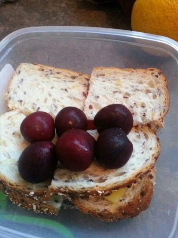lunch - cheese tomato sandwich, six cherries, orange
