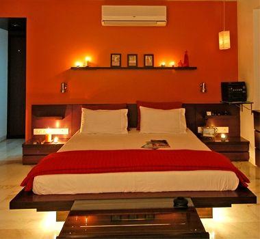 orange wall in bedroom