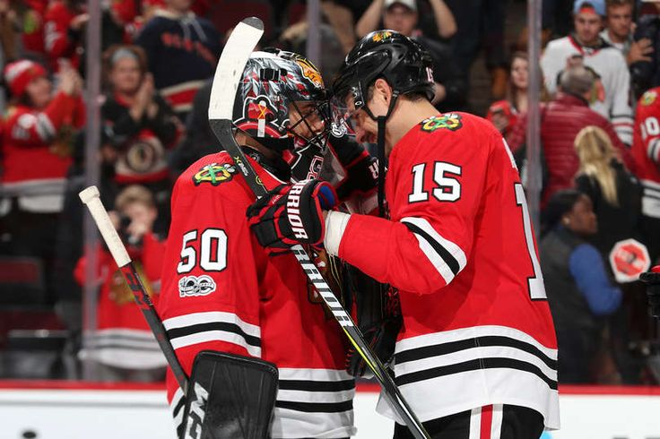 CHICAGO, IL - NOVEMBER 15: Goalie Corey Crawford #50 and Artem Anisimov #15 of the Chicago Blackhawks celebrate after defeating the New York Rangers 6-3 at the United Center on November 15, 2017 in Chicago, Illinois. (Photo by Chase Agnello-Dean/NHLI via Getty Images)