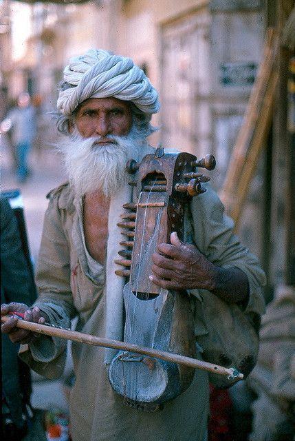 A musician in Jaisalmer, Rajasthan, playing an old sarangi.