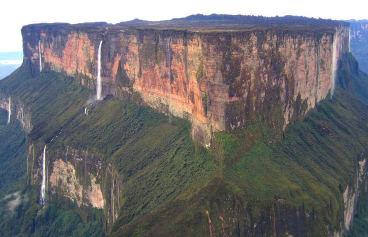 Mount Roraima is the highest of the Pakaraima mountain chain in South America. The 31 square kilometer summit area is defined by 400 meter tall cliffs on all sides and includes the borders of Brazil, Venezuela, and Guyana. The tabletop mountains of the Pakaraima's are considered some of the oldest geological formations on Earth, dating back to some two billion years ago.