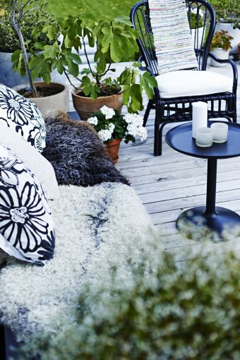 Make yourself at home in your garden with cushions and blankets.
