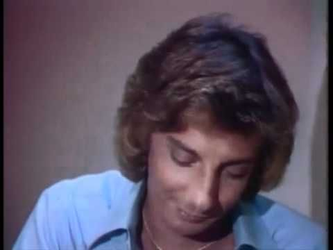 "When I watch Barry Manilow I think of two things. I remember listening to I Write The Songs in my friend's bedroom when I was a kid. I also think about Joe Montana when I see him. Click the picture to listen to ""I Write the Songs."""