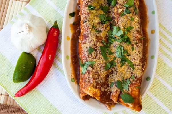 Where Mexican cuisine and comfort food meet, you get these delightfully Guilt-Free Vegan Enchiladas with a spicy homemade sauce.