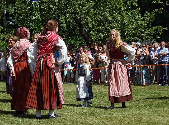 Traditional Dancing Dancers from the Sorunda Folkdanslag dancing around the Midsummer Pole wearing the Sorunda regional dress.