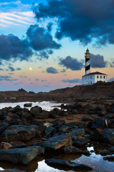 Favaritx Lighthouse, Menorca - One of the most picture perfect views in the Balearic Islands. See more at https://wanderlusters.com/picture-perfect-places-stay-balearic-islands Photo by  Ferran Pulg