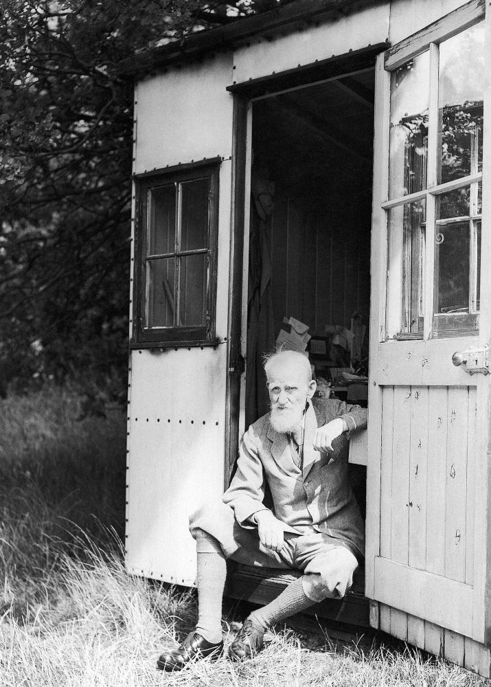 George Bernard Shaw's 'London' Hut Hidden at the bottom of Irish playwright Shaw's garden was a rotating hut, which he built himself and wrote in. The story goes he called it 'London', so that if somebody called for him, they could be told he was in London and it would be true! The hut was built to rotate so Shaw could move it from inside to be in the sunshine constantly while he worked. Sounds pretty good to us. Here he is pictured sitting in it in 1944. IMAGE: PA