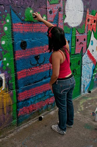 Girls participating in the *legal* graffiti scene for a an art competition in Medellin, Colombia. Artist: Niña Gato