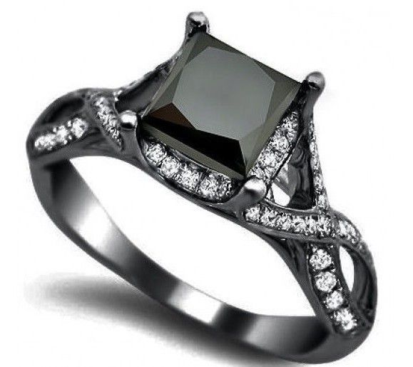 black diamond ring-- different. I Love It! (over the white diamond thing, I want a black diamond)