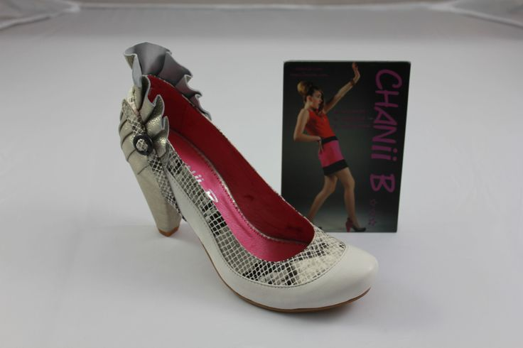 Chanii B. So stunning in Ivory White and silver heel.
