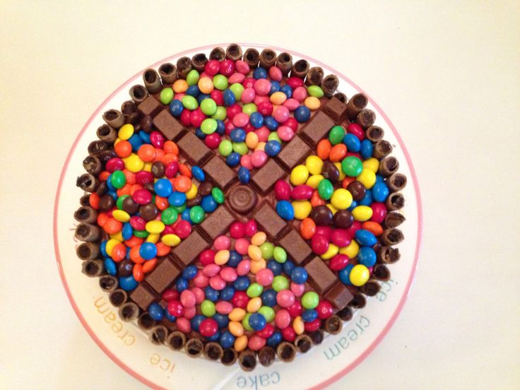 """""""Covered In Candy Birthday Cake"""" I used yellow cake, chocolate cream cheese frosting, regular and peanut butter m&ms,  kit-kats, rolos, skittles and pirouettes. Fun and Yummy!"""