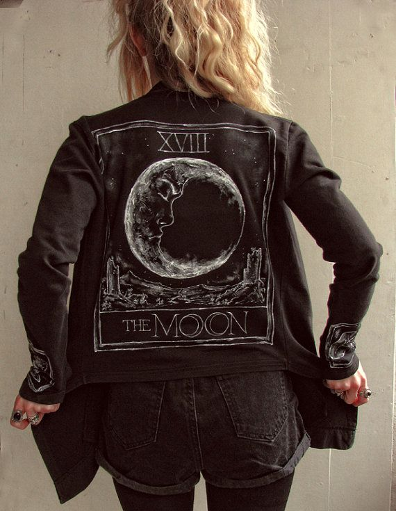This black cotton cardigan features a handpainted illustration of the Tarot card The Moon on the back, and the Tarot symbols Coin and Cup. Asymmetric front with two almost invisible pockets. Without lining. Painted with acrylic textile colors, machine washable up to 40 degrees, I recommend washing it with only 30 degrees with gentle cycle. The color is lightfast. For exact measurements or if you have any questions, dont hesitate to contact me! All clothes I paint on are vintage...