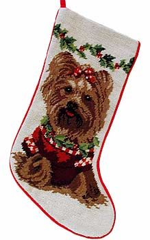 "Yorkie in Sweater Needlepoint Christmas Stocking, from Dogstuff.com. Because your best pal wants treats from Santa, too. This festive 10"" by 15"" stocking depicts a sweetly dressed Yorkie in impressive 100 percent wool needlepoint. Features a soft velveteen backing and a loop for hanging by the chimney with care."