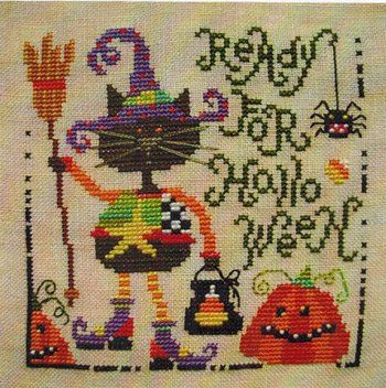 Barbara Ana Designs Halloween Cat - Cross Stitch Pattern. Model stitched 32 Ct. Autumn Blush Linen with DMC cotton floss, DMC Color Variations, and Weeks Dye Wo