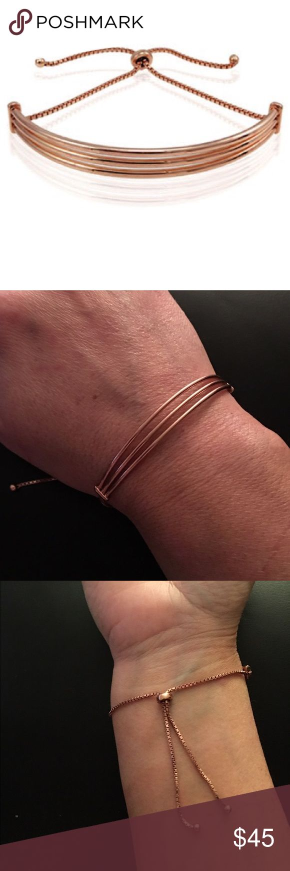 """Rose gold plated curved bar bracelet Sleek rose gold bracelet that adjusts to snd wrist. Length up to 10"""" due to adjustable nature of bracelet. Very fun and stylish. Great as layering piece. Bracelet is brand new, never worn and comes in velvet pouch. No trades. Reasonable offers only please. Bundle for further discounts. Ships in 24hrs. Gift with purchase Lord & Taylor Jewelry"""