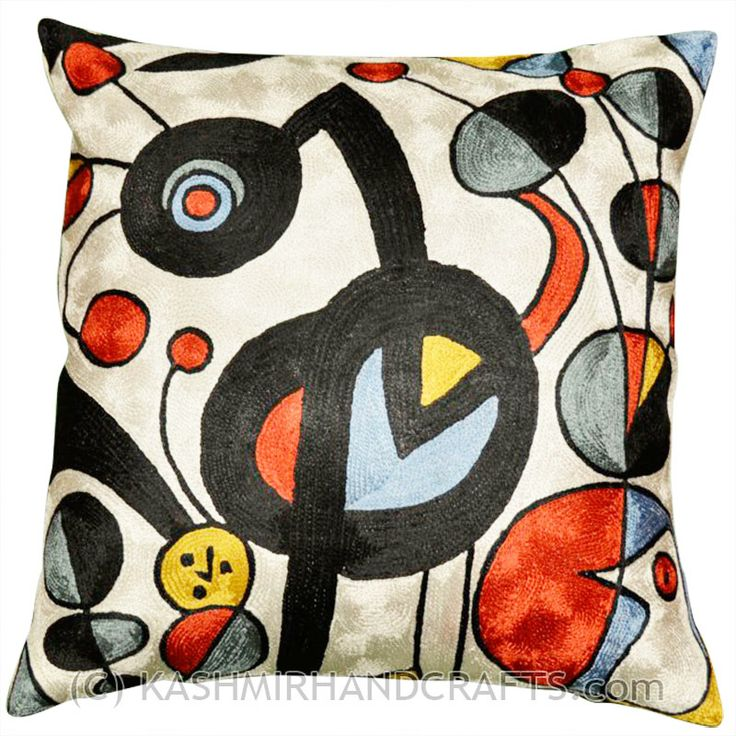 MIRO-WHITE-GARDEN-EMBROIDERED-DECORATIVE-PILLOW-COVER. Expertly handcrafted chain-stitch embroidery with a design inspired by the works of modern artist, Joan Miró. The abstract qualities of this piece, as well as the juxtaposition of primary colors and pastels of this decorative cushion cover, create a vibrant point of interest for your décor. Created of soft Kashmir wool over cotton, this all-natural cover makes an enduring impression.