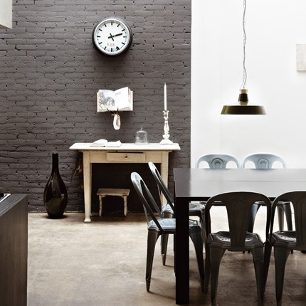 Painted brick in charcoal gray.