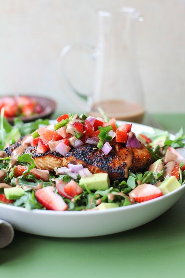 Grilled salmon arugula salad with strawberry salsa, avocado, and strawberry balsamic vinaigrette