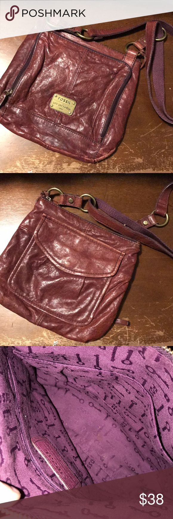 Body Fossil purse It has a longer strap to hang over the shoulder or however you'd like. It is a deep red/purple. It has many pockets and compartments for being a thinner purse. It lays flat. There are no issues with it except on the zipper the tag came off so you have to grab the zipper to unzip. It is really not difficult at all the zipper it's self works perfectly. And as a fellow posher I always except counters😊 Fossil Bags Shoulder Bags