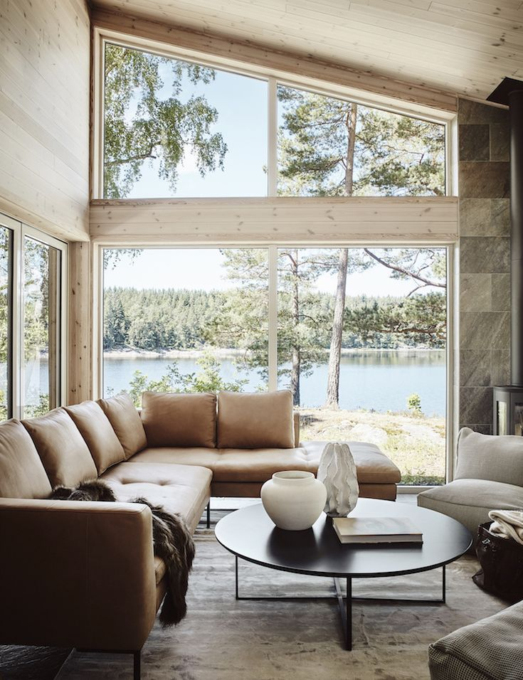 A Scandinavian Lakeside Cabin in Warm Ochre and Neutral Hues (my