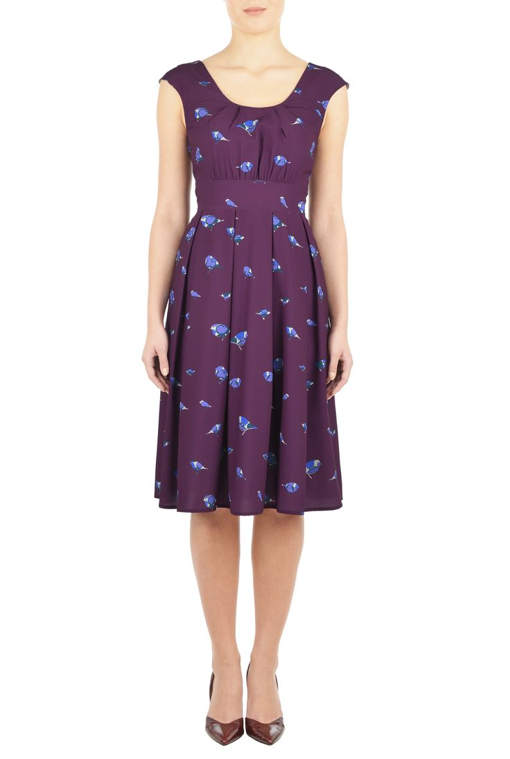 Pretty pleats detail the scooped neck of our bird print crepe dress, nipped in at the banded waist for a figuring-flattering silhouette.
