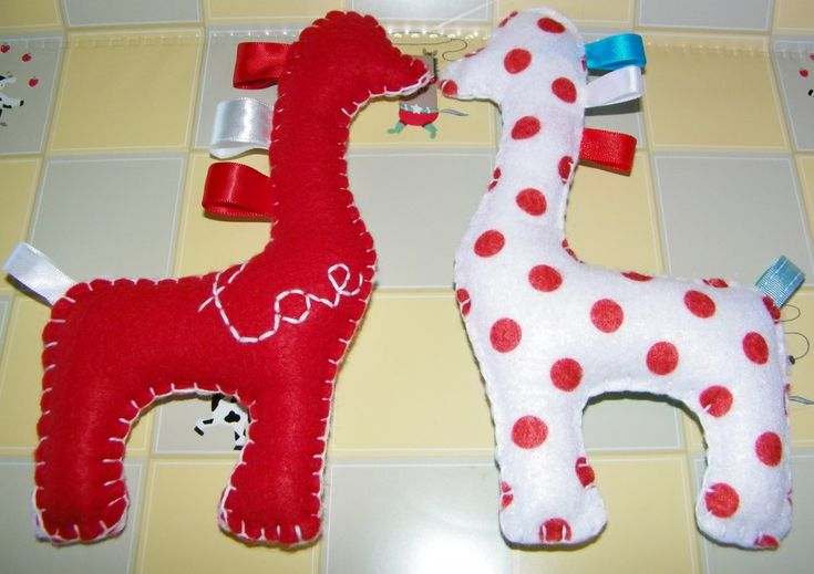 Baby Felt Toy Giraffes  -- easy for little hands to hold. (Don't think I would use felt, though.)