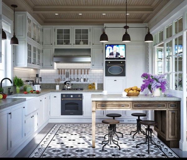 Of course, the kitchen here is certainly nothing to sneeze at. Similar glass-front cabinets are gorgeous while patterned floor tile definitely stand out.