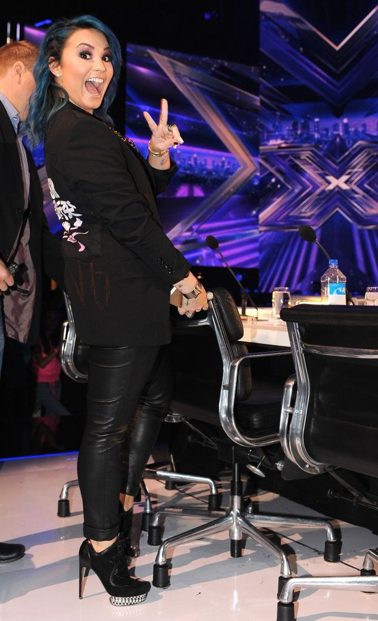 "Peace in the U.S.A. Demi Lovato shows some excitement during a taping of ""The X Factor"" on Nov. 21 in Hollywood, Calif."