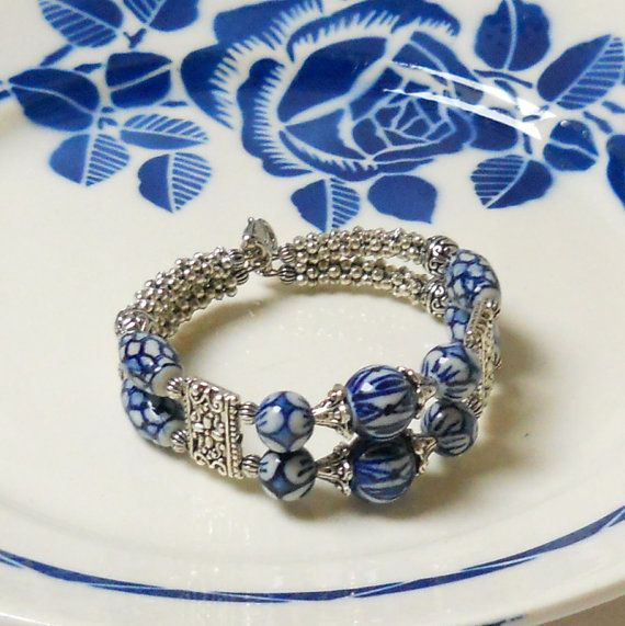 Double strand bracelet made of handpainted Delft blue style ceramic beads and silvertone metal beads and beadcaps. Suitable for wrists up to 19 cm. ( 7.5