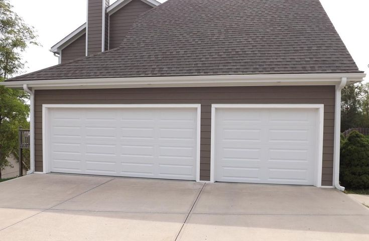 Clopay premium series long panel white parkville mo for Buy clopay garage doors online