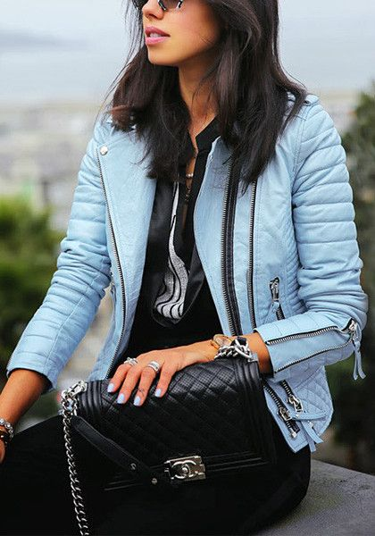 Girl in light blue quilted PU jacket
