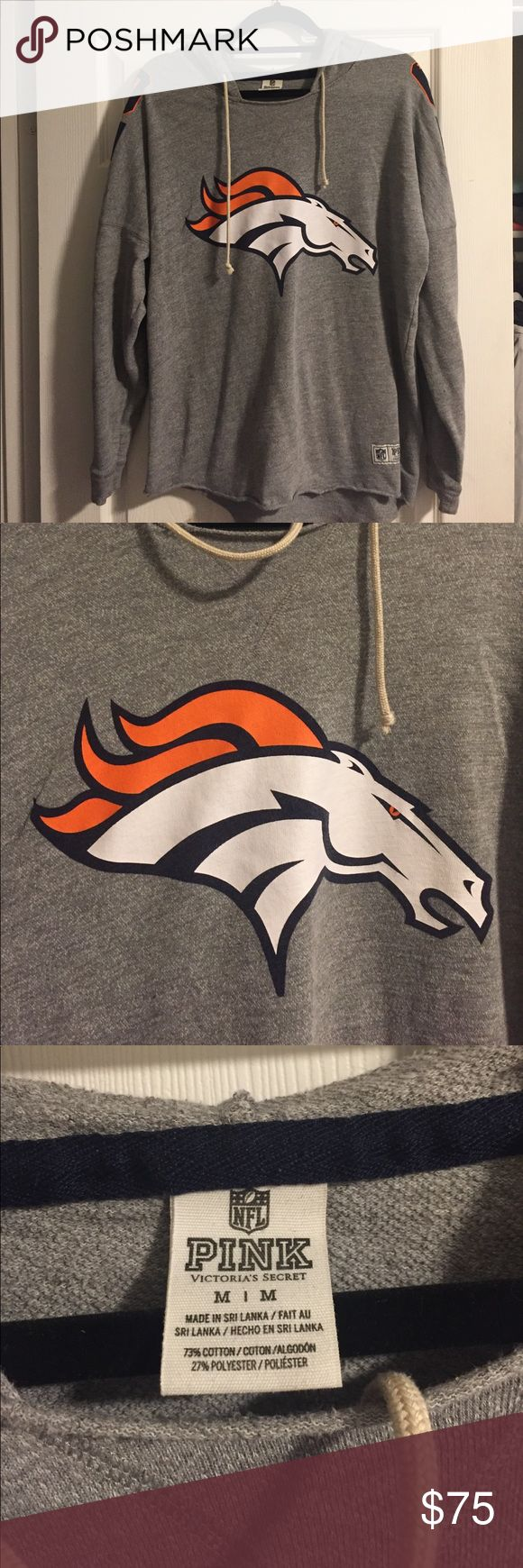 Denver Broncos Pink Sweatshirt Longer length Denver Broncos sweatshirt. Size medium but is a relaxed fit. Great condition.  No holes, rips or tears. PINK Victoria's Secret Tops Sweatshirts & Hoodies