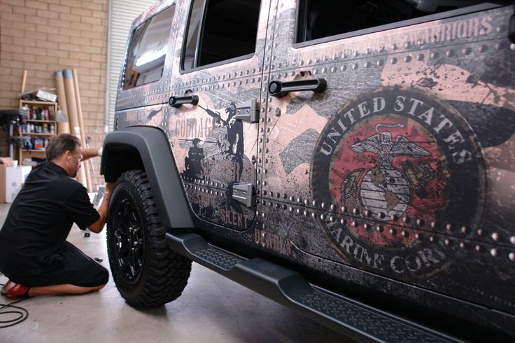 Working on a Jeep Wrangler wrap at the DesertWraps.com warehouse in Palm Desert, CA. We work with companies based in Palm Desert, La Quinta, Indian Wells, Palm Springs, Cathedral City, Riverside, San Bernardino, Redlands. Call 760-935-3600