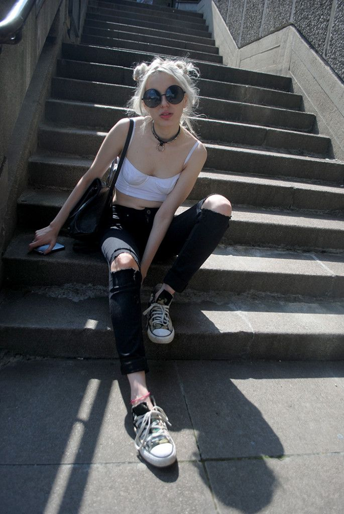 Black and white summer outfit, space buns and oversized black sunnies.