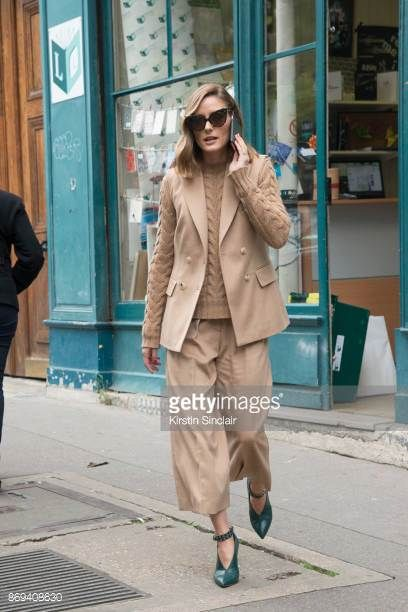 Model and Socialite Olivia Palermo wears Jimmy Choo shoes Balmain sweater Max Mara jacket sunglasses and trousers day 3 of Paris Womens Fashion Week...