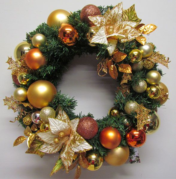 Copper and gold baubles look amazing in a Miss Haberdash wreath.