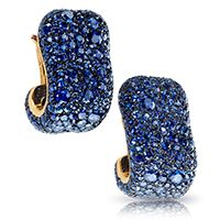 Fabergé Émotion Bleue Earclips  This piece is set in 18 carat yellow gold and silver and features 609 blue sapphires and ruby totalling 15.16 carats.