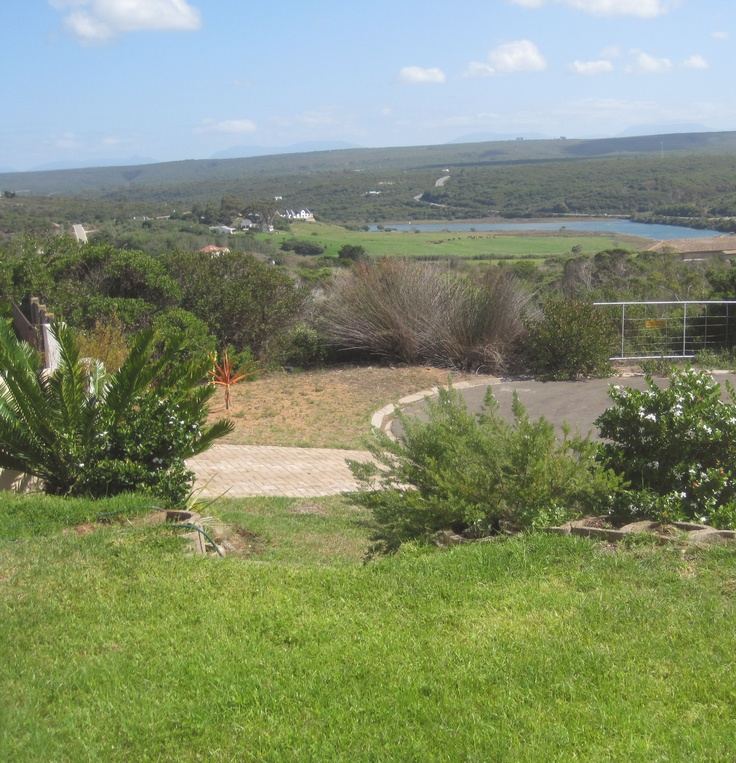 """As you drive along the navigable Goukou River and watch it spill into the warm Indian Ocean, you instantly fall in love with Stilbaai – the warmth and the sense of community as well as the miles of gloriously sandy beaches (""""Lappiesbaai"""" has been awarded the prestigious Blue Flag Award). The sand dunes are splashed with colour as they are sprinkled with a rainbow of wild flowers."""