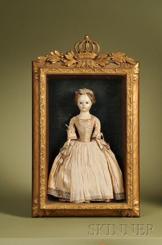 Queen Anne memorial doll in giltwood shadow box case, Continental, c. 1735