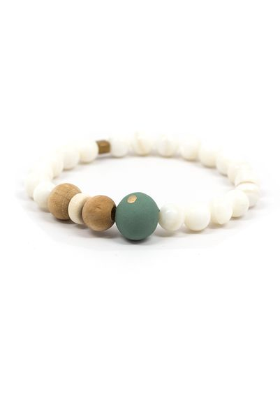 Add some soft colors and bold shapes to that bracelet collection! That perfect little gold dot and the intriguing mix of beads makes for a style you'll never want to take off. Dimensions: Approximatel
