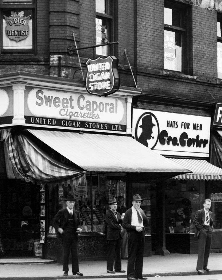 Hastings and Carrall, September 1940 Men in front of the Templeton Block on the northeast corner. Full image. Source: Photo by Leonard Frank (cropped), City of Vancouver Archives #Bu P297